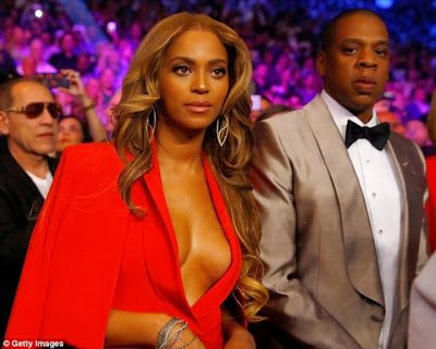 Beyonce flashes boobs at ''Fight Of The Century'' in a red hot cleavage baring outfit