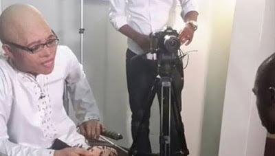 Photo: Anas removes mask for an interview with BBC