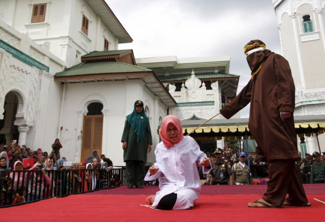 "Indonesia: Unmarried Couple publicly caned for being ""too close"""