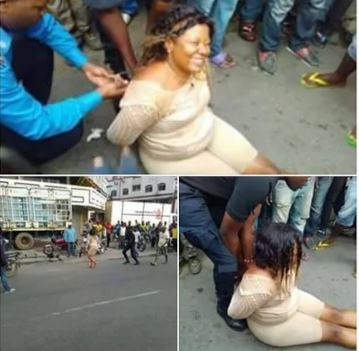 WomanGoesMadInPublic2Cabandonscar2CStripsHerself Photos - Woman Goes Mad In Public, Abandons car, Strips herself - Photos