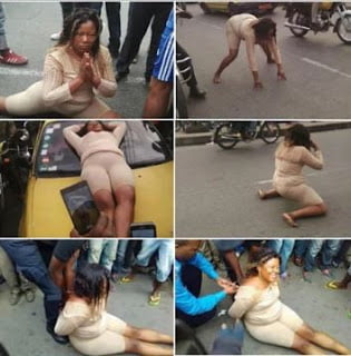 WomanGoesMadInPublic2Cabandonscar2CStripsHerself Photos3 - Woman Goes Mad In Public, Abandons car, Strips herself - Photos