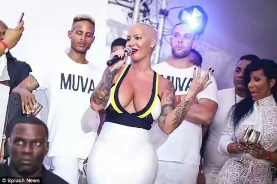 Photos: Amber Rose squeezes giant curves in a body-fitting dress as she parties in the Caribbean