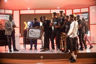 Sarkodie Presented With Paintings Of Mum And New Baby Titi