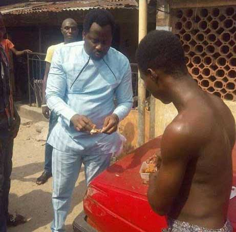 Desmond Elliot eats bread and beans at the roadside